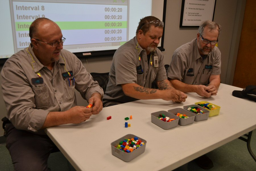 The 5 Gen class participates in the Lego exercise.