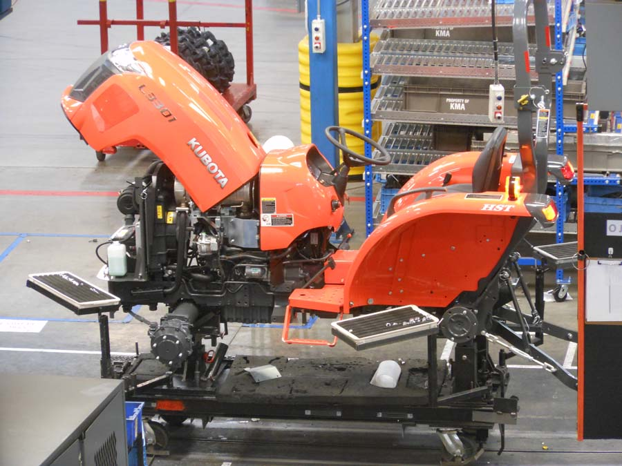 A tractor in mid-assembly at KIE.
