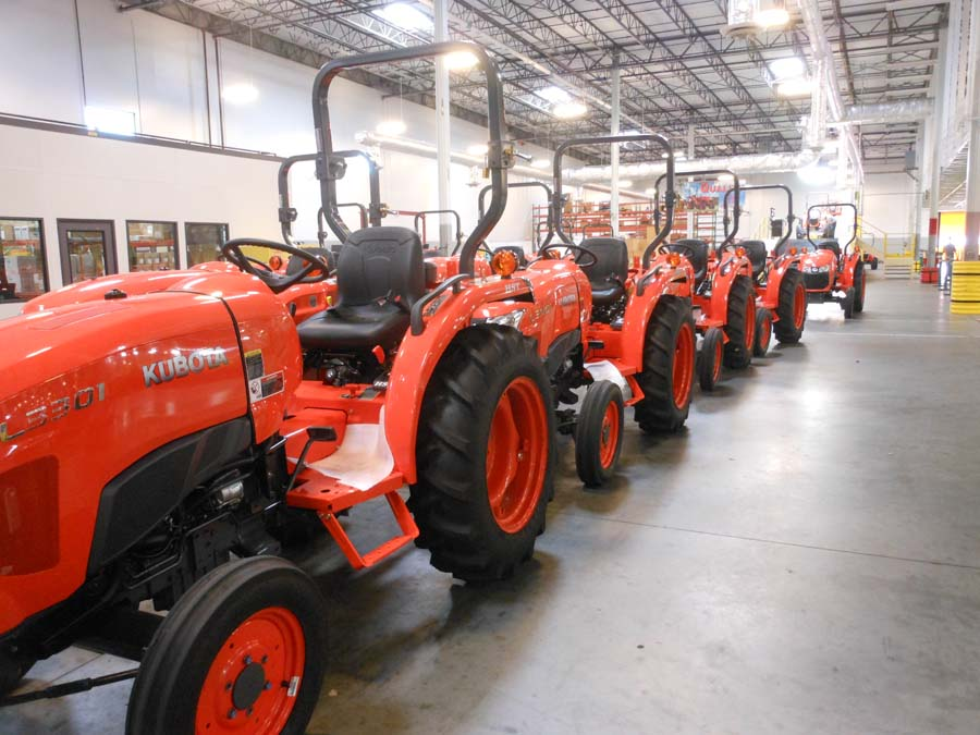 An L series tractor going through the inspection process at KIE.